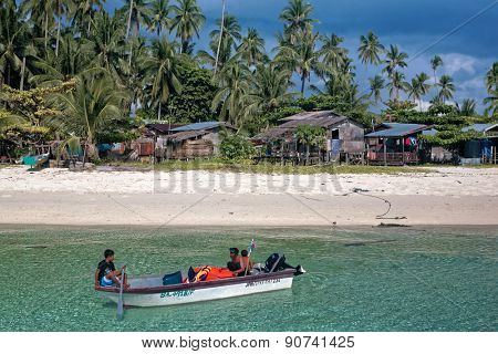 JUNE 28, 2008 - SABAH, MALAYSIA: An unidentified sea gypsy family takes a boat out to sea from their village on Mabul Island, Sabah, Malaysia.
