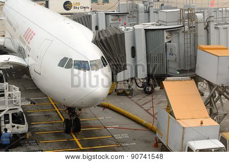 HONG KONG - MARCH 09, 2015: aircraft docked in Hong Kong International Airport. It is the main airport in Hong Kong. It is located on the island of Chek Lap Kok