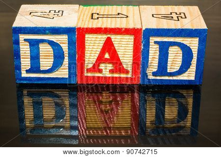 Dad written with toy blocks