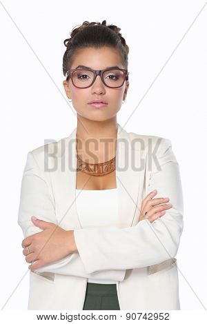 Portrait of businesswoman standing with crossed arms .