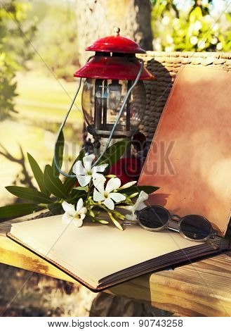 Poet workplace. Summer background. red retro Lantern, old book,