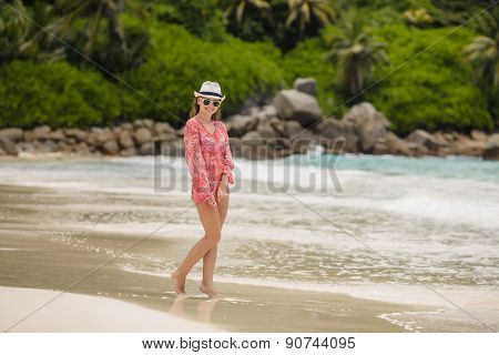 Young female enjoying sunny day on tropical beach