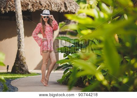 Beautiful young woman relaxing in the Seychelles
