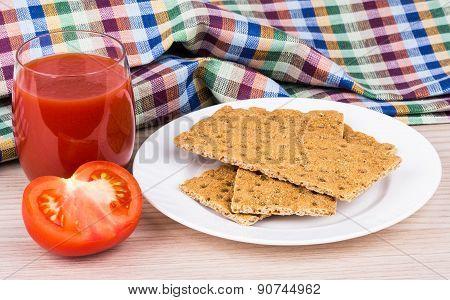 Wheat Crisp Bread, Tomato And Juice On Table