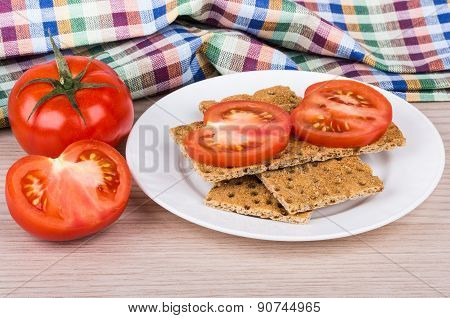 Wheat Crisp Bread, Tomatoes And Towel On Table
