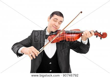 Young male musician playing an acoustic violin with his eyes closed isolated on white background