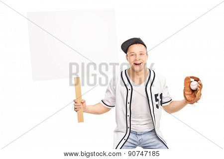 Excited baseball fan holding a ball and a blank banner and looking at the camera isolated on white background