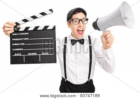 Young movie director with a black beret holding a clapperboard and speaking on a megaphone isolated on white background
