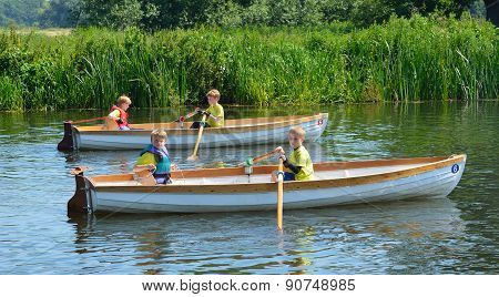 Children in rowing boats
