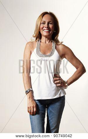 Senior Woman Is Looking Good, Wearing Skinny Jeans