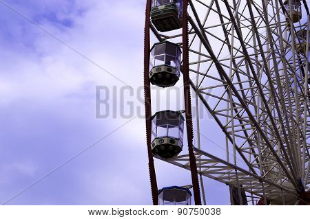 Ferris Wheel On The Blue Sky With Clouds Background. Kharkiv