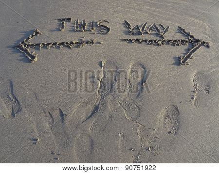 This Way Sand Writing And Footprints Upon Beach