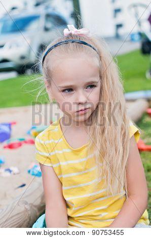 Portrait of beautiful sad little girl