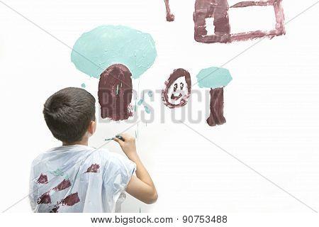 Boy Paints Picture.