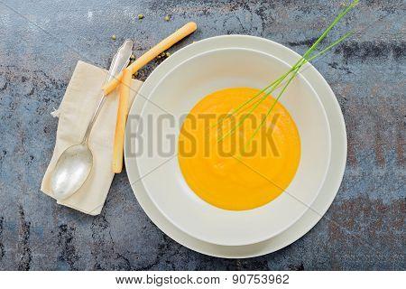 Delicious healthy pumpkin soup, spoon and napkin