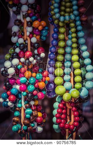Beads Of Round Colorful Stones Lie On The Counter Of Souvenir Shop