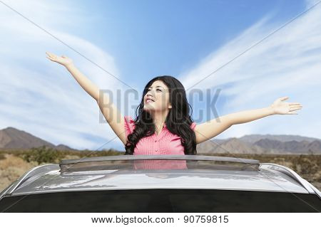 Cheerful Woman On Sunroof Of Car