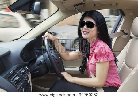 Happy Woman Steers A Car