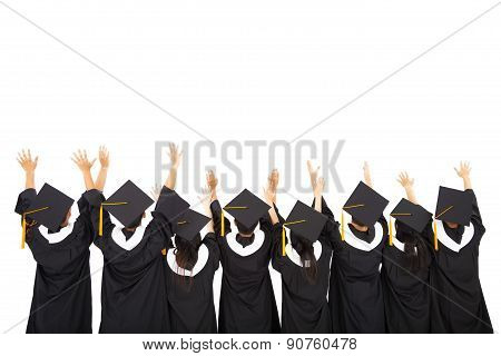 Rear View Of  Students Celebrating Graduation