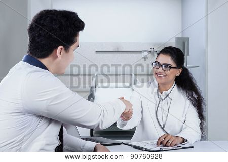 Male Patient Shaking Hands With Doctor