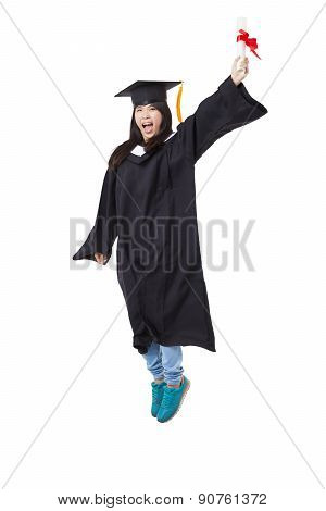 Happy  Student In Graduate Robe Jumping Isolated On White