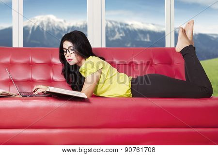 Pretty Girl Studying On Sofa