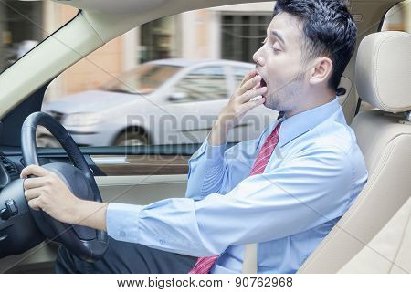 Tired Man Driving A Car