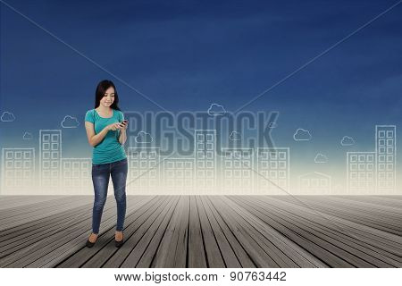Woman Sending Information With Smartphone 1