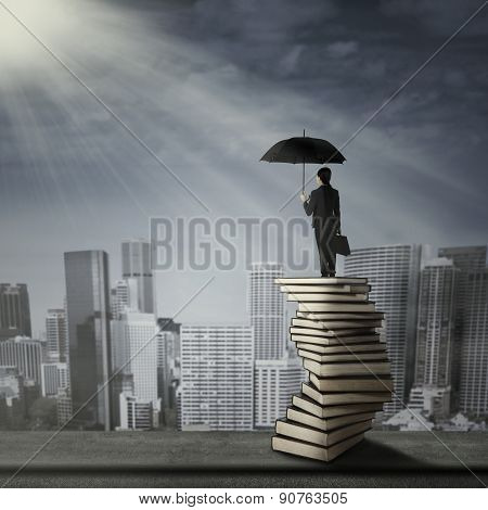 Woman Standing On A Pile Of Book