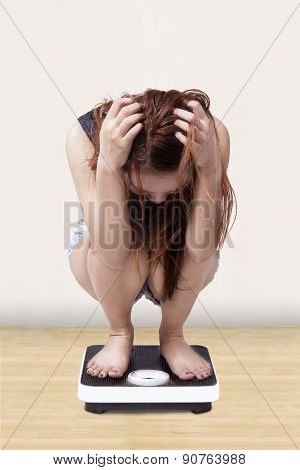 Worried Girl Measure Her Weight