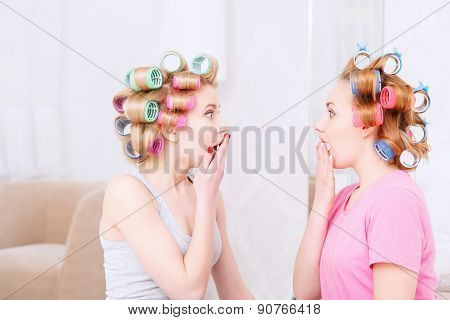 Young girls sharing secrets