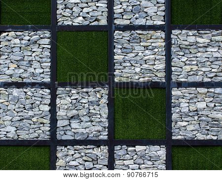 Stone walls and artificial grass background texture