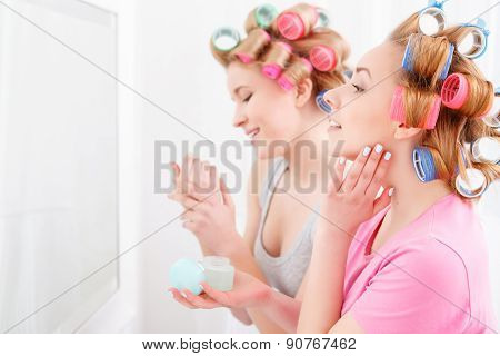Two young girls near the mirror