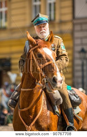 KRAKOW, POLAND - MAY 3, 2015: Polish cavalry during annual of Polish national and public holiday the May 3rd Constitution Day. Holiday celebrates declaration of the Constitution of May 3, 1791.