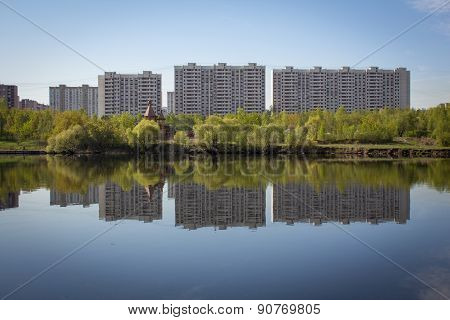 Multi-storey Buildings Are Reflected In The Water