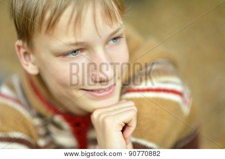 Boy in autumn park
