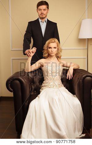 Luxury couple in rich interior