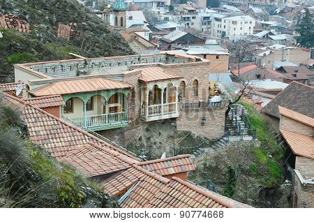 Unfinished house, where there is no roof, but there are carved balconies. Tbilisi, Old Town
