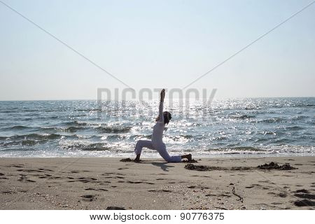 Yoga Pose At The Beach