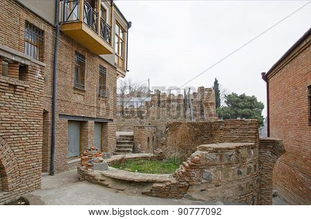 Remains of Isani fortress bastions among houses. Tbilisi