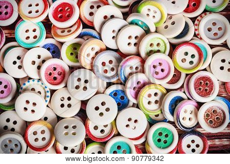 Multi Colored Buttons On A Wooden Background