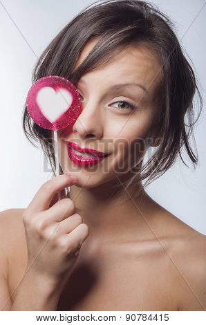 Portrait of a girl with a lollipop