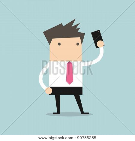 Businessman taking selfie using a mobile phone