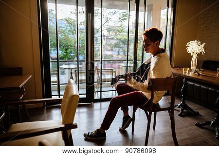Asian Guitarist Artist Man Play Guitar In Cafe