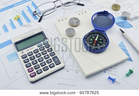 Compass, Pen, Glasses And Calculator On Paper Graph, Investment Concept