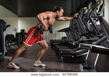 Mature Man Working Out Back