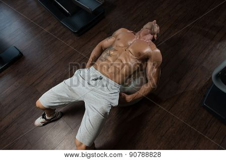 Attractive Men Doing Sit-ups With Exercise Ball