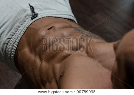 Mature Man Working Out With An Exercise Ball