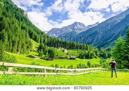 Photographer and alpine landscape in Alps, Austria