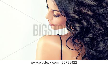 Beautiful girl model with long black  curled hair